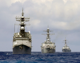 USS Thorn (DD 988), USS Cole (DDG 67), and the USS Gonzalez (DDG 66), members of the Enterprise Carrier Strike Group, perform divisional tactics while underway in the Atlantic Ocean